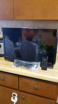 black flat screen TV with remote Wilmington, 28405