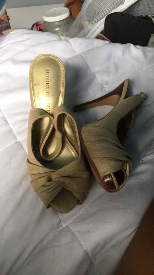 pair of brown leather open toe ankle strap heels