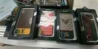 three assorted iPhone cases in boxes Vaughan, L4K 3A8