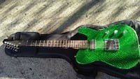 green and black acoustic guitar Vancouver, V5T 0B5