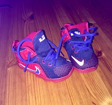 red-and-blue Nike lace-up sneakers