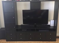 black wooden TV hutch with flat screen television Toronto, M8V 4G6
