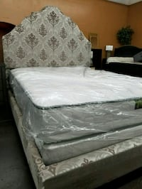 Traditional fabric upholstered bed with mattress