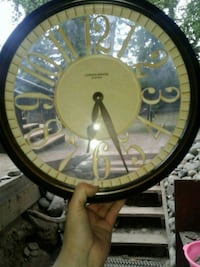 "Clock,  battery operated 12""-13"""