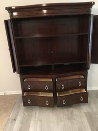 flat screen television with brown wooden TV hutch 663 mi