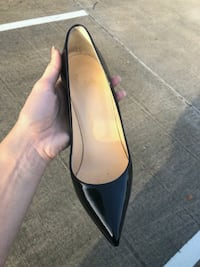 pair of black leather pointed-toe flats Calgary, T2E 0R4