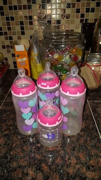 baby's four pink and clear plastic feeding bottles Manassas, 20110