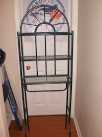 Green metal shelf . Dimensions are : 23 w x 11 d x68 h. Located at mavis and bristol in mississauga Mississauga