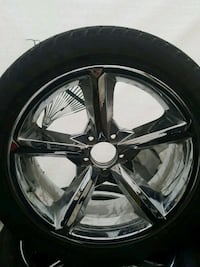 chrome 5-spoke car wheel with tire Westbank, V4T 2H4
