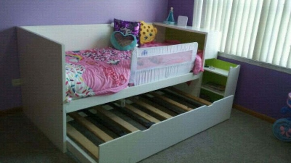 white wooden trundle bed with mattress