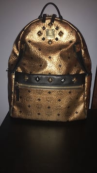Mcm dual  stark gold backpack (PRICED TO SELL ASAP FOR CAR) Port Coquitlam, V3C 5M7