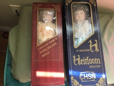 two female porcelain dolls in packages