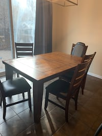 rectangular brown wooden table with four chairs dining set Milton
