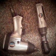 gray and black Craftsman pneumatic impact drill and socket wrench
