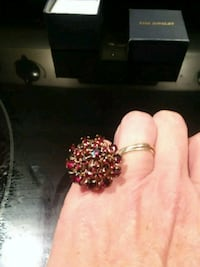 18 karat gold with 25 gemstone ring 64 km