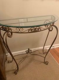 Glass topped  gold iron console table