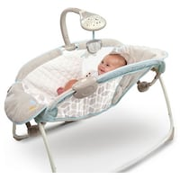 gray and teal rock and play sleeper, never been used, in unopened box.  Upland, 91786