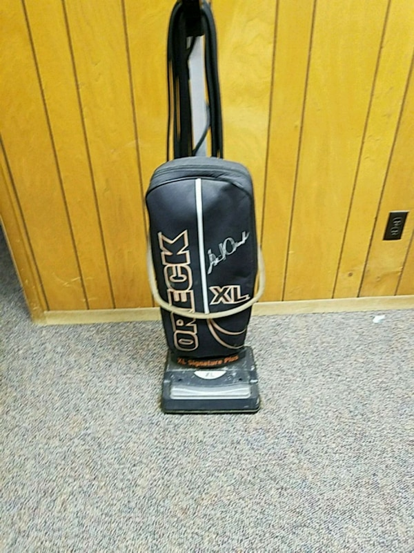black and gray Oreck upright vacuum cleaner