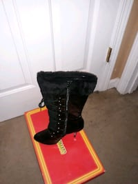 Black boot with fur and heels.  Size 10