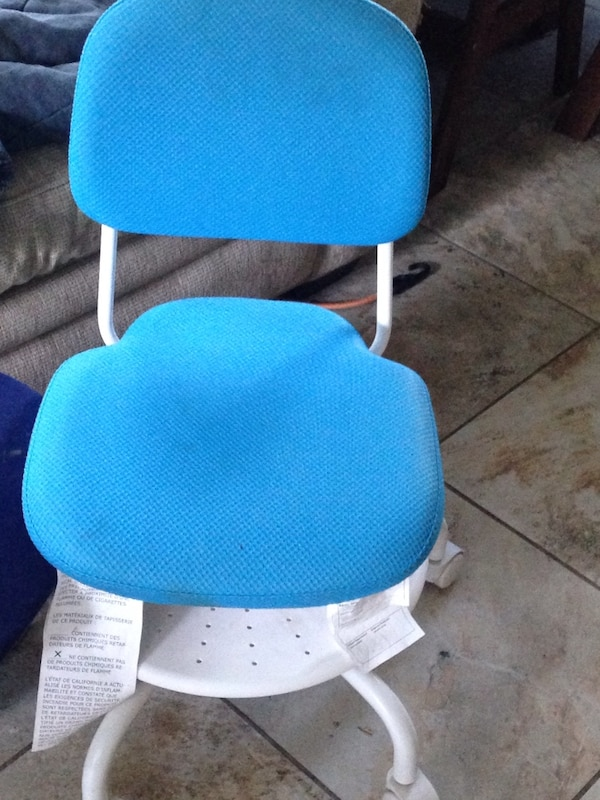 Blue and white rolling chair