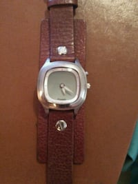 round silver analog watch with black leather strap Pinellas Park