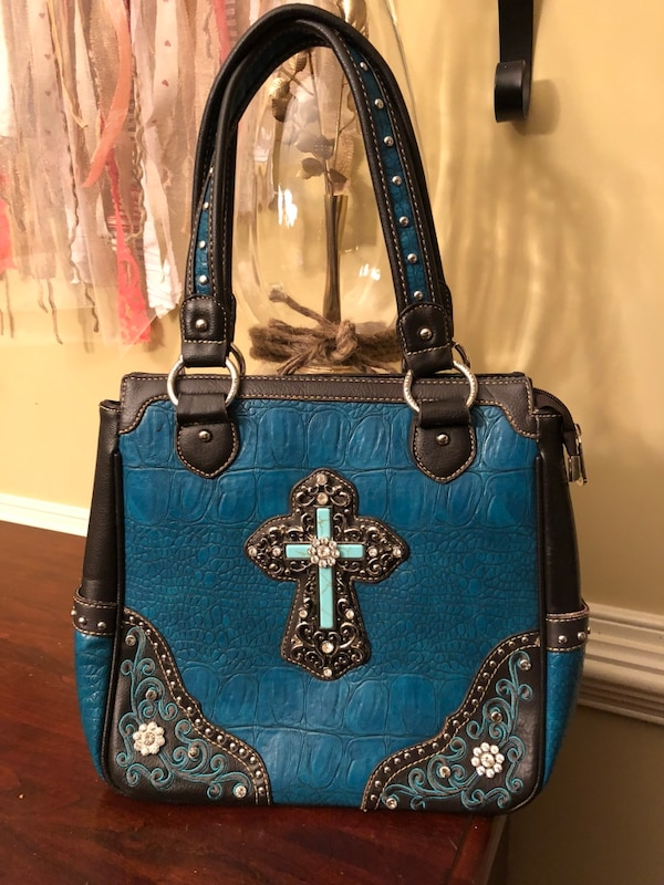 9aee0378ca15 Used Blue and black leather tote bag for sale in Hiram - letgo