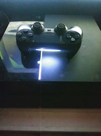 black playstation controller with console New York, 10452