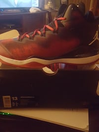unpaired black and red Air Jordan basketball shoe with box