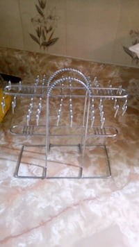 clear glass-top table with gray steel base 537 km