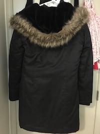 Black winter jacket with fur on the inside.  1965 km
