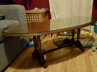 Oval glass-topped coffee table Smiths Falls, K7A 4E8