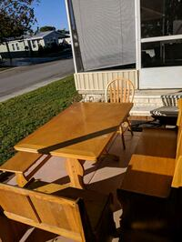 brown wooden table with chairs 792 mi