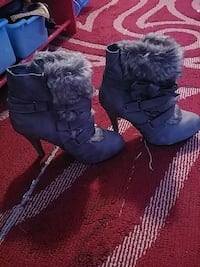 pair of gray sheepskin buckled heeled winter boots