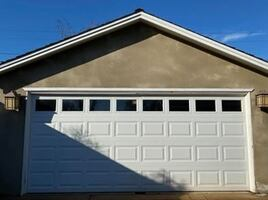 2-Car garage door and belt drive with 2 remotes.