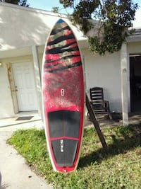 red and black surfboard with black and red surfboard Cape Canaveral, 32920