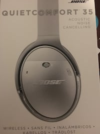 round gray and white Bose portable speaker Point Of Rocks, 21777