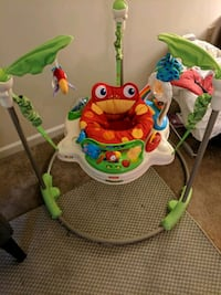 baby's green and white Fisher-Price jumperoo 5 km