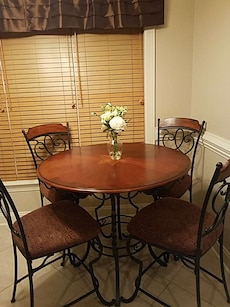 Dining room table and 4 chairs.  Sat in one time.
