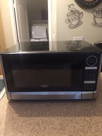 black and gray Oster microwave oven Los Angeles, 90012