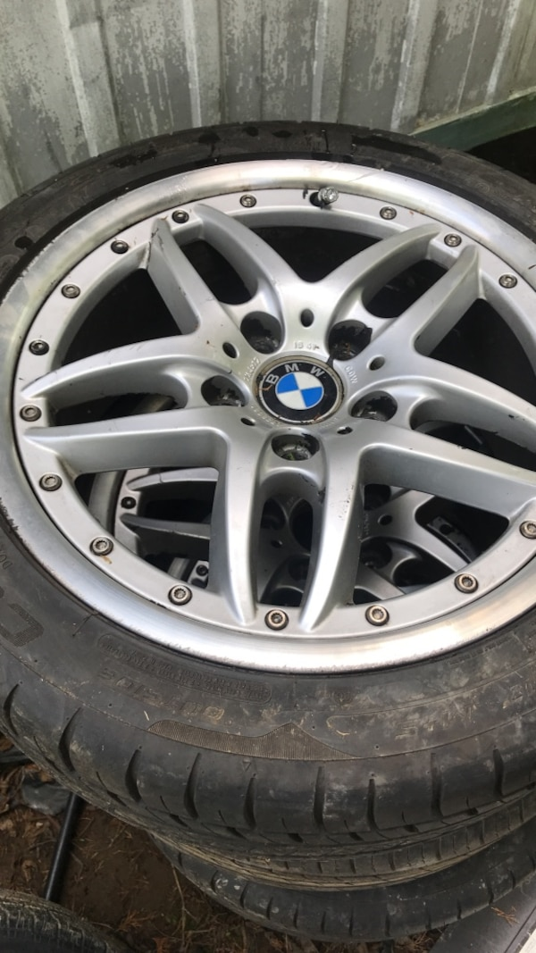 silver BMW car wheel with tire