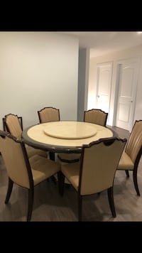 Beautiful marble dining set with six chair The top of table is movable Surrey, V3R 3W7