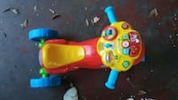 toddler's yellow and blue ride on toy