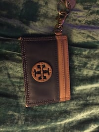brown and black Tory Burch leather wristlet 19 mi