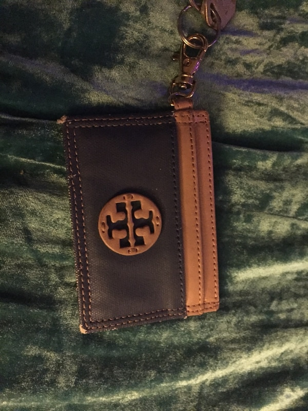 Brown and black tory burch leather wristlet