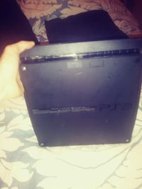 Sony PlayStation 3Slim 120GBCharcoal Black Console with games.