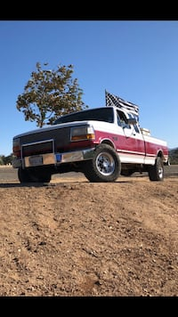 Red and white single cab pickup truck 2230 mi