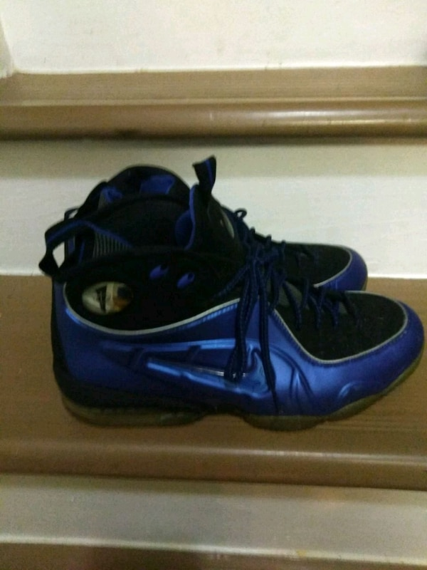 pair of black-and-blue Nike basketball shoes 09528a8b-87a8-421c-acbd-062990125243