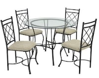 round black metal framed glass top table with chairs Houston, 77043
