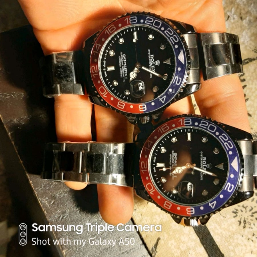 Watches, black with blue/red bezel.