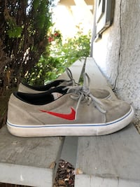 Grey and red Nike shoes size 10 men  Los Angeles, 90028